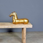 golden-horse-laying-iron